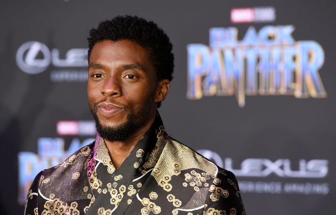 "In this Jan. 29, 2018 file photo, Chadwick Boseman, a cast member in ""Black Panther,"" poses at the premiere of the film in Los Angeles. Boseman, who played Black icons Jackie Robinson and James Brown before finding fame as the regal Black Panther in the Marvel cinematic universe, died of colon cancer on Aug. 28, 2020 in Los Angeles. He was buried on Sept. 3, in Belton, South Carolina, about 11 miles from his hometown of Anderson."