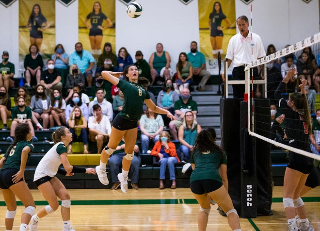 Trinity Catholic's Chloe Teter goes airborne to spike the ball in the third set. The Celtics defeated Orangewood Christian in three straight sets, 25-17, 25-10 and 25-7, in the 3A, Region 1 quarterfinals Thursday night.