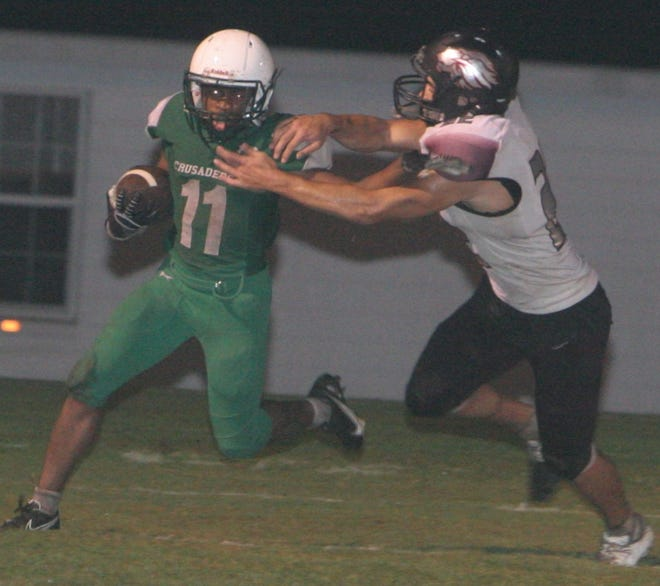 Ocala Christian junior running back Keiron Williams fights for extra yards during Thursday night's game against Faith Christian.