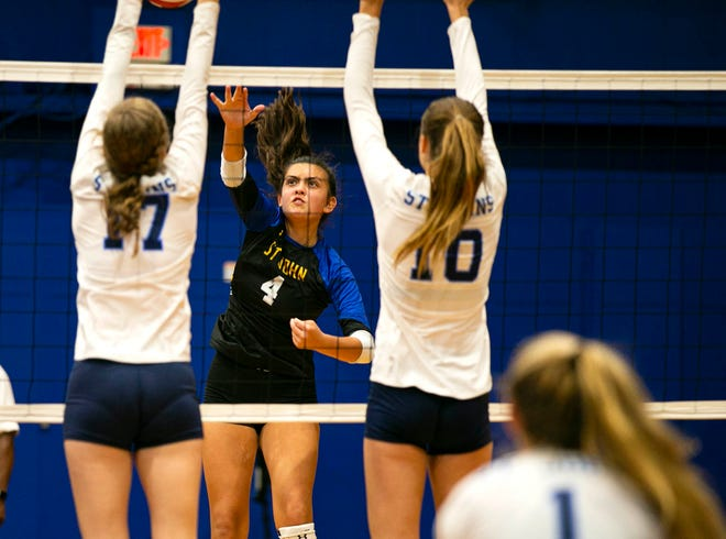 St. John Lutheran's Sophia Ochoa matches up against St. Johns Country Day's #17 Kinley Hall and #10 Ashlyn Anderson in the Class 2A Region 1 quarterfinal on Thursday. The Saints fell to the Spartans in four sets: 25-22, 25-22, 24-26, 25-15