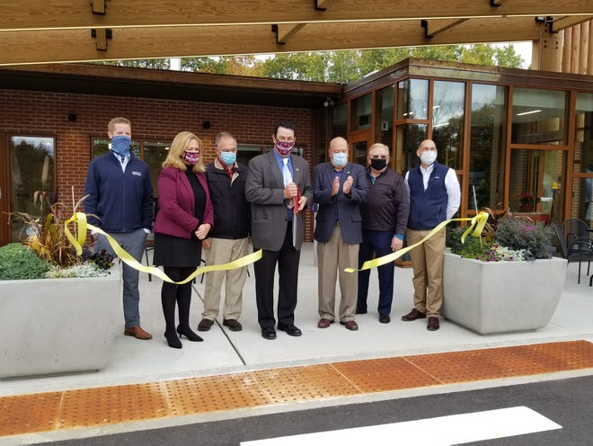Portsmouth city officials join together as Mayor Rick Becksted cuts the ribbon to officially open the city's new senior center on Cottage Street on Friday, Oct. 23, 2020. (Courtesy)