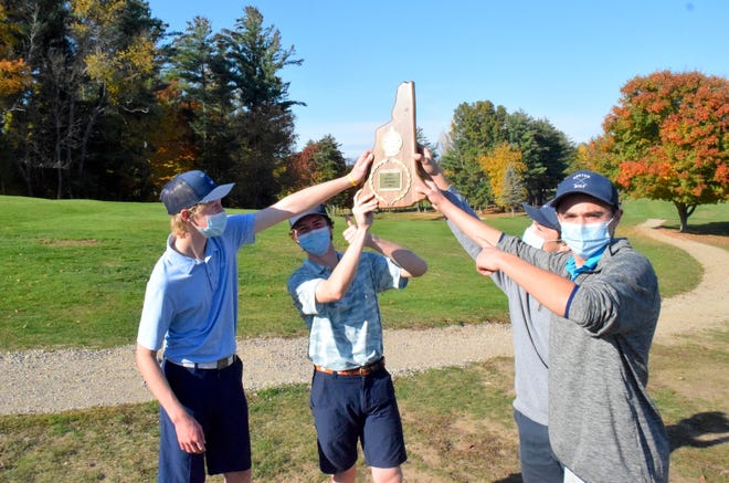 Exeter High School golf team members, from left, Connor Allard, Will Ducharme, Liam Walsh and Matt McConnell show off the Division I state championship plaque Thursday at Exeter Country Club. All four players broke 80 as Exeter earned the school's first team golf championship in 31 years.