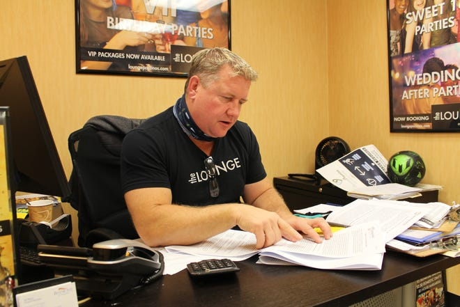 Steve Ertle, manager of The Lounge at Baymont Inn in Bartonsville, looks through pages of regulations aimed at restaurants and bars during the COVID-19 pandemic. Ertle and several others in the Poconos' hospitality industry have questioned the state government's strategy to help their businesses weather the storm, and are advocating for their own solutions that may provide better assistance.