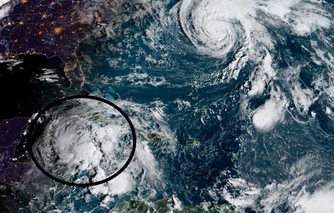 Invest 95L (bottom left) and Hurricane Epsilon.