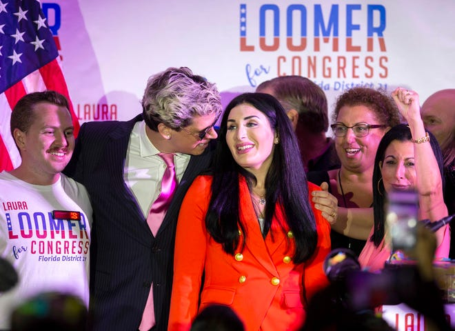 Republican congressional candidate Laura Loomer celebrates with Milo Yiannopoulos (left) and campaign director Karen Giorno (right) at an election night event in August.