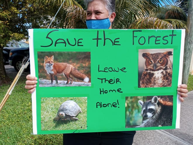 A resident''s poster shows some of the animals found in a forested area in unincorporated Boynton Beach that could be wiped away by development.