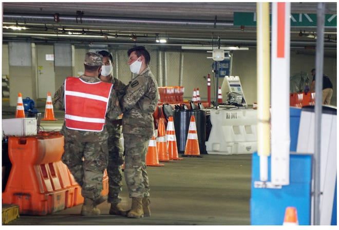 National Guard personnel man a COVID testing site at the Rhode Island Convention Center parking garage in July.