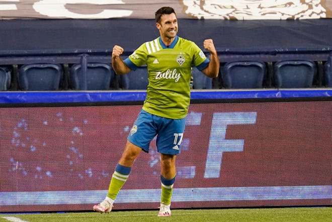 Seattle Sounders' Will Bruin reacts after scoring in stoppage time against the Portland Timbers in the second half of an MLS soccer match, Thursday, Oct. 22, 2020, in Seattle. (AP Photo/Elaine Thompson)