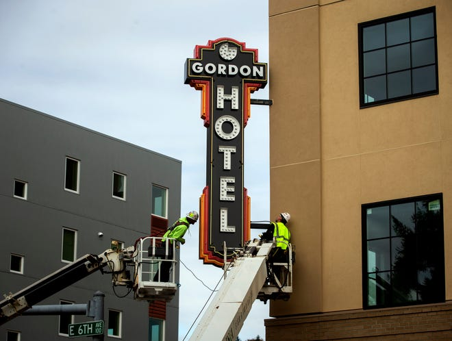 Workers with Eugene Sign and Awning install the sign for the new Gordon Hotel on East 6th Avenue and Oak Street Oct. 23. The seven-story 82-room hotel is slated to open in early 2021.