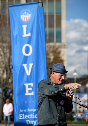 Doug Pagitt leads a Vote Common Good rally Friday at Stark County Courthouse plaza.