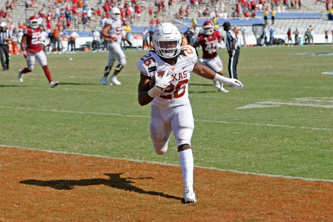 Texas running back Keaontay Ingram (26) scores a touchdown against Oklahoma during the second half of an NCAA college football game in Dallas on Oct. 10.