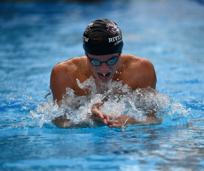 Liam Custer of Riverview High won the state title in both the 200 IM and the 500 free Saturday at the Florida High School Athletic Association Class 4A meet in Stuart.