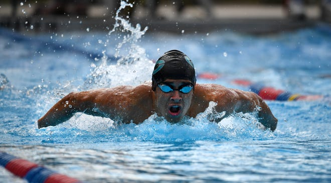 Jack Stokvis of Gulf Coast High competes in the heat 3 finals in the boys 100 yard butterfly during the FHSAA 2020 Class 4A, District 6 swim meet in Sarasota on Friday, Oct. 23, 2020. Stokvis won the heat.