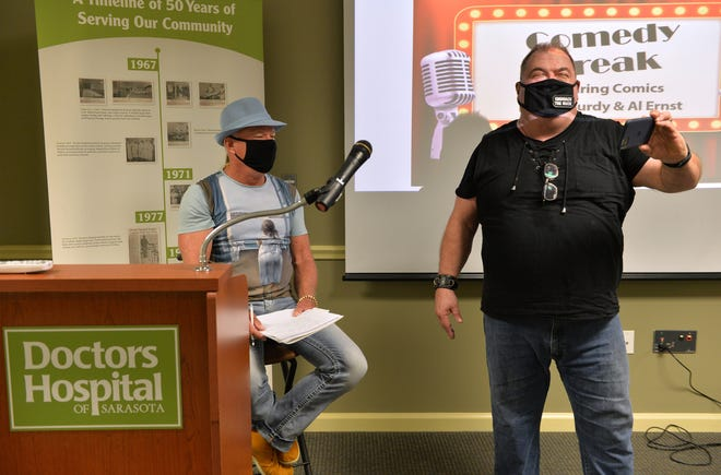 Les McCurdy, left, creates a Facebook Live post with fellow comedian Al Ernst before a performance for frontline workers on Aug. 18 at Doctors Hospital in Sarasota. McCurdy's Comedy Theatre in downtown Sarasota reopens on Nov. 20.