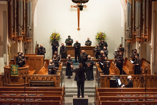 """Key Chorale Chamber Singers, led by artistic director Joseph Caulkins, recording the """"Together We Rise"""" streaming concert at Church of the Redeemer."""
