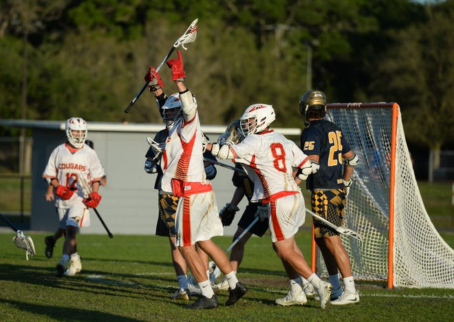 Cardinal Mooney's Christian Laureano celebrates a goal during a lacrosse game against St. Thomas Aquinas in 2018. Sarasota County is considering investing in more athletic fields for lacrosse and other youth sports.