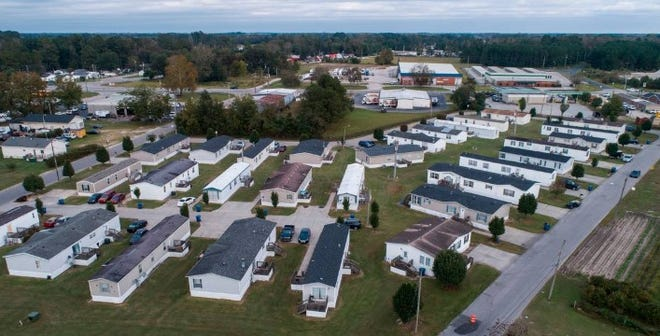 Abbott Park, a mobile home park in Lumberton, N.C., pictured here on Friday, Oct. 16, 2020, is owned by Time Out Communities. According to an Associated Press report, the company bought almost all of the mobile home parks in Lumberton after Hurricane Florence. Researchers examining the health effects of rising temperatures in counties like Robeson, which is located in the Sandhills region of the state, are looking at how higher temperatures can impact residents of mobile home parks and exacerbate social vulnerabilities.