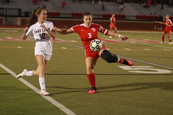NFA senior Cassidy White (3) looks to clear the ball against East Lyme defender Meredith Healy (12) during the Wildcats' 4-1 win on Oct. 1 in Norwich. [Laura Howe/For The Bulletin]