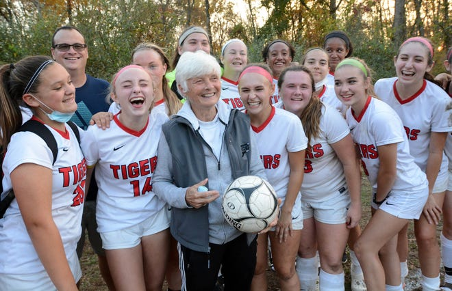 Tourtellotte coach Deb Spinelli celebrates with her team after winning her 300th game, a 6-0 victory over Parish Hill Thursday in Chaplin.