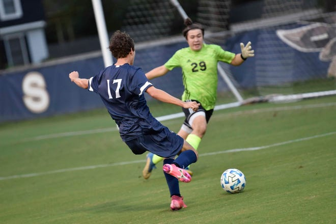 Fayetteville Academy's Anthony Sevilla gets a shot off against Thales Academy of Apex during a second-round NCISAA playoff game on Thursday, Oct. 22, 2020, in Fayetteville.
