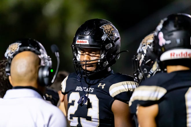 Buchholz tight end Gavin Hill listens to his coach during the game vs. Steinbrenner at Citizens Field earlier this month.