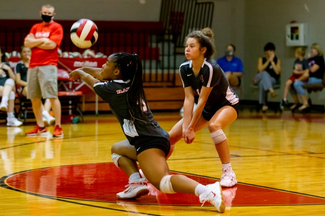 Santa Fe libero Miya Thomas (5) stretches for a dig during Thursday's regional playoff against the Panama City Bay Tornadoes at the Santa Fe High School gym in Alachua.