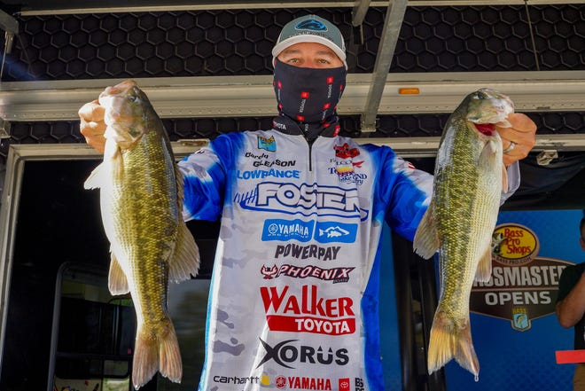 Darold Gleason of Many, La., showing off two of his catch, leads after the first day of the Basspro.com Bassmaster Central Open at Gadsden's Neely Henry Lake with 13 pounds, 12 ounces.