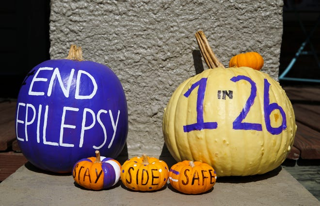 Purple pumpkins are seen on Kat Freisen's front porch in Tuscaloosa Friday Oct. 23, 2020. The pumpkins are a way of raising awareness of epilepsy and the Purple Pumpkin Project is conducted by the Epilepsy Foundation. [Staff Photo/Gary Cosby Jr.]
