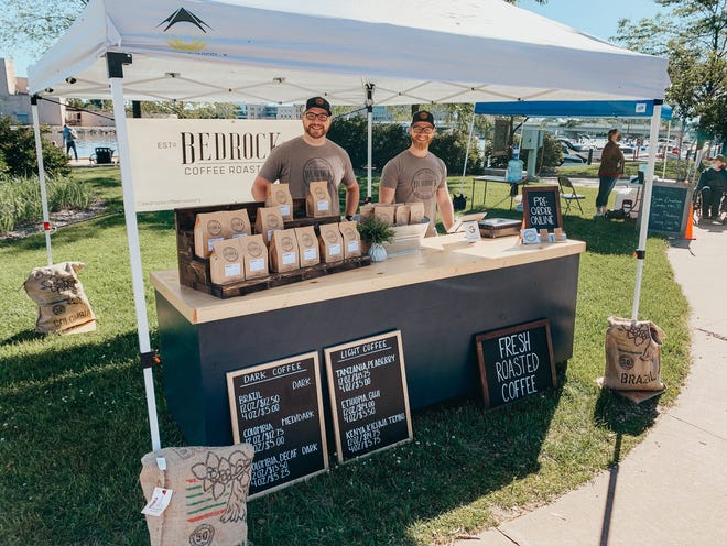 Jeff Conner, left, and Danny Ozsvath are founders of Bedrock Coffee Roasters. They had a booth at the Neenah Farmers Market this past summer and are now establishing a permanent base in Neenah.