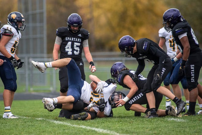 Lakeview junior Brendan Allard (76) tackles St. Joseph freshman Andrew Barlow (43) on Friday, Oct. 23, 2020 at Lakeview High School in Battle Creek, Mich.