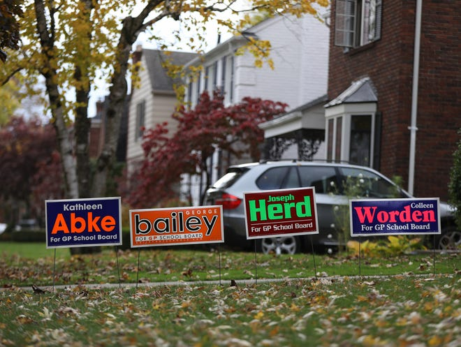 Political yard signs for Grosse Pointe School Board candidates Kathleen Abke, George Bailey, Joseph Herd, Colleen Worden in front of homes in Grosse Pointe, Mich. on Oct. 21, 2020.