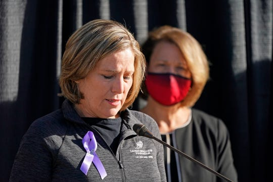University of Utah President Ruth Watkins, right, looks on as Jill McCluskey, the mother of slain University of Utah student-athlete Lauren McCluskey speaks during a press conference announcing they have reached a settlement in their lawsuit against the university Thursday, Oct. 22, 2020, in Salt Lake City.