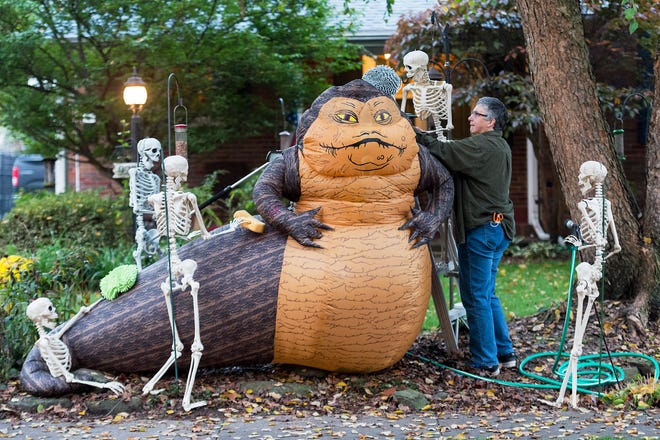 "Ann Dixon sets up her ""Skeleton Crew"" giving Jabba the Hutt, from the popular film series Star Wars, a bath in front of her home off South Lombard Avenue in Evansville, Ind., Thursday morning, Oct. 22, 2020. Inspired by the scavenger hunts from the early days of the COVID-19 pandemic, Dixon has arranged her skeletons every day in a variety of scenes for people to enjoy since May."
