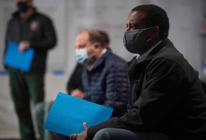 U.S. House Rep. Joe Neguse listens to a briefing on the East Troublesome Fire and the Cameron Peak Fire, the top two largest wildfires in Colorado history, at the Incident Command Center at the Budweiser Events Center in Loveland, Colo. on Friday, Oct. 23, 2020.