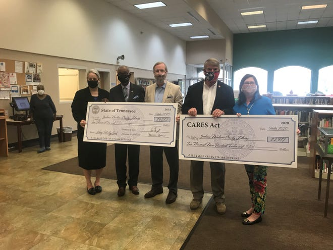 Library Director Dinah Harris, State Representatives Johnny Shaw and Chris Todd, State Senator Ed Jackson and Library Board Chairman Elaine Christian were all on hand for the check presentation at the library this week.