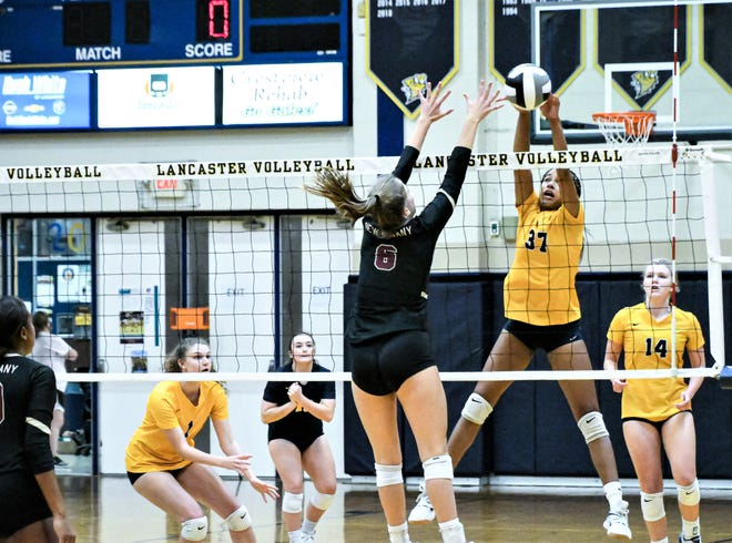 Riley Westbrooks hits the ball over the net while a New Albany opponent attempts to block. Westbrooks finished with 18 kills to help lead the Golden Gales to a 3-1 tournament win Thursday night.