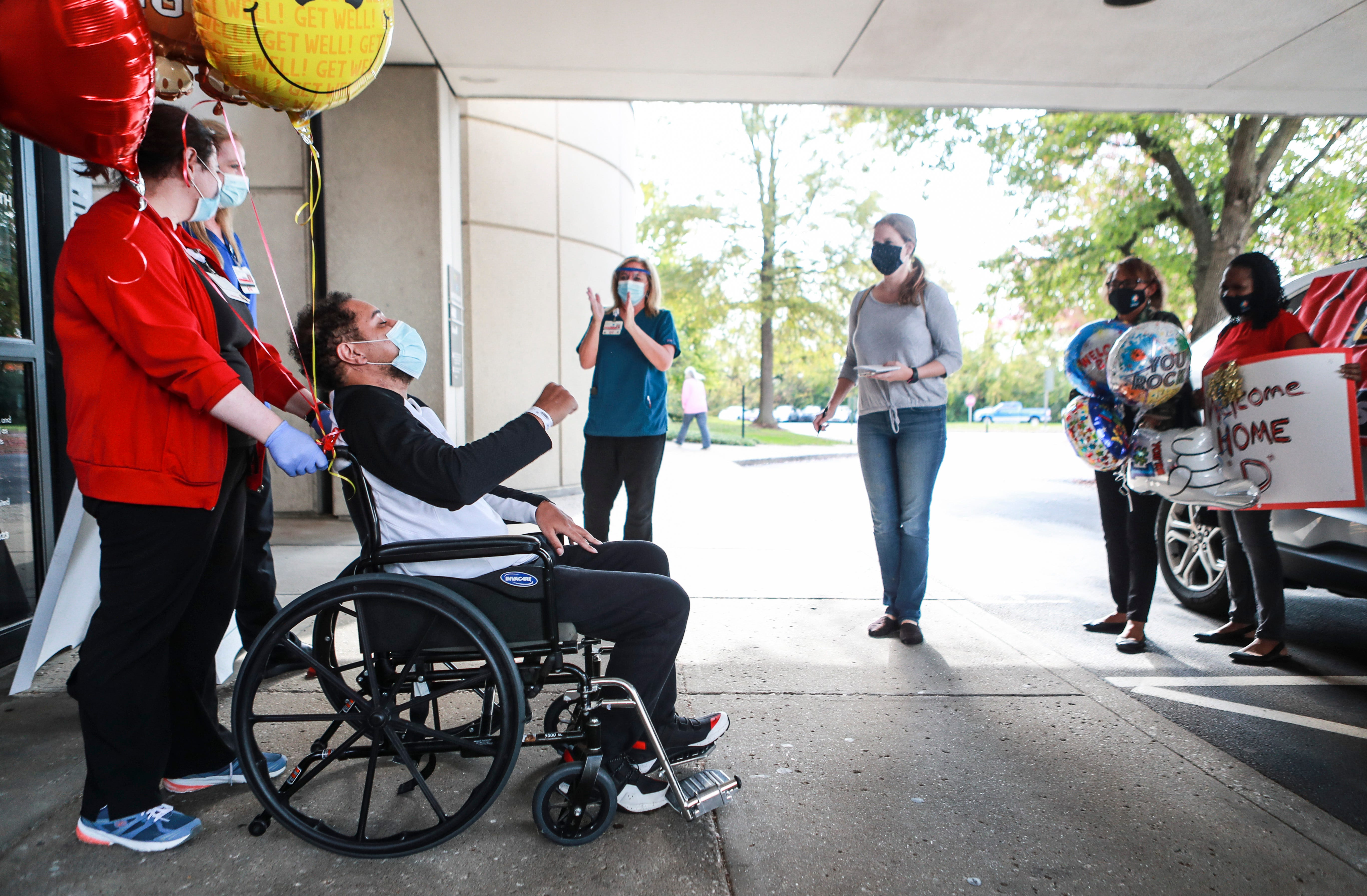 After battling COVID-19 for more than 90 days, Demetrius Booker celebrates his release from Louisville Baptist East on Friday to finally go home. Oct. 23, 2020