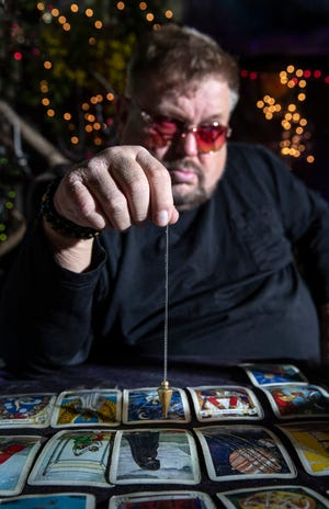 Psychic Senate write-in candidate Hal Fitzpatrick  tells fortunes in his booth at the Lake Cumberland Flea Market. Oct. 23, 2020