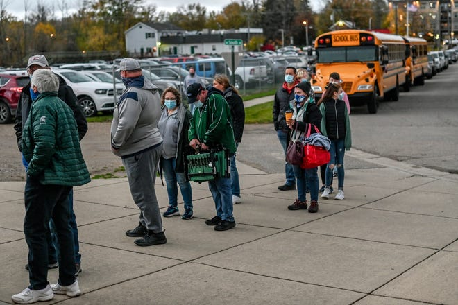 Fans wait in line to get into the stadium before Williamston takes on Mason on Friday, Oct. 23, 2020, in Williamston.