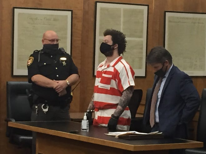 Terrance Jenkins was sentenced Friday to at least nine years in prison for attempted murder and three other charges. He is flanked by Dwight Hicks, a corrections officer for the sheriff's office, and defense attorney Jon Spaulding.