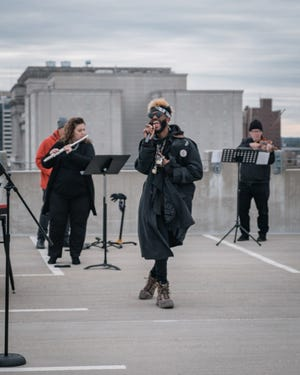 Hip-hop star Klassik performs with Present Music in a rooftop concert recorded for online viewing.