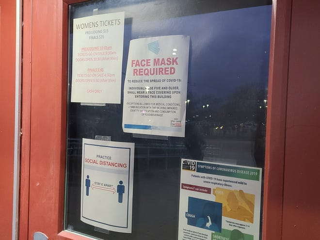 These signs greeted guests attending the NPC Badger State competition at the Waukesha County Expo Center on Oct. 17. A Milwaukee woman said the mask order was largely ignored at the event, prompting her to write a call to local officials who she feels haven't done enough to enforce coronavirus-safety rules.