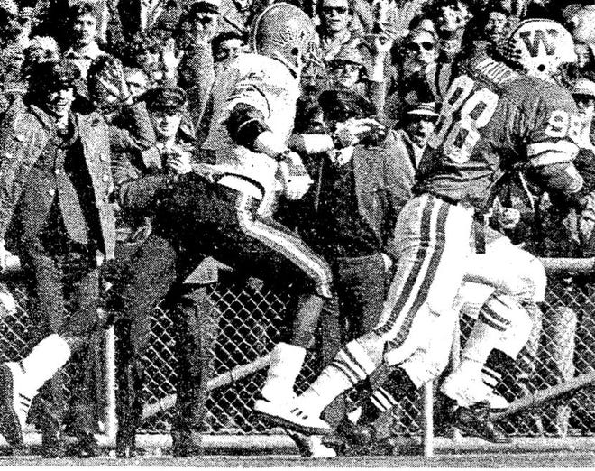 Jeff Nault rumbles the last couple steps to the end zone ahead of Illinois defensive back Craig Swoope to cap off a thrilling play Oct. 23, 1982.