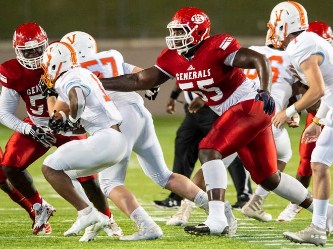 Lee's Anquin Barnes (55) chases the ball carrier at Cramton Bowl in Montgomery, Ala., on Thursday, Oct. 22, 2020. Lee leads Valley 27-0 at halftime.