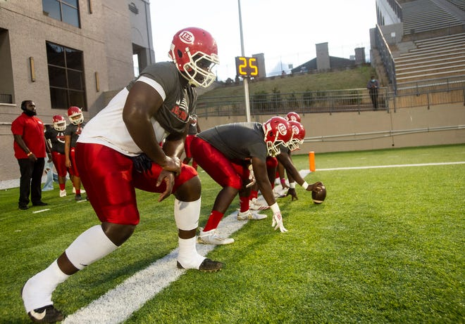Lee's Anquin Barnes (55) warms up at Cramton Bowl in Montgomery, Ala., on Thursday, Oct. 22, 2020. Lee leads Valley 27-0 at halftime.