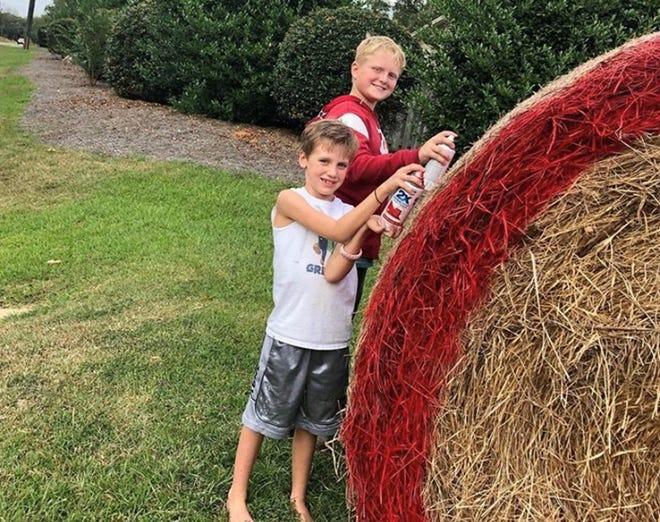 Volunteers fashion the Gray Ridge neighborhood hay bale in 2019.