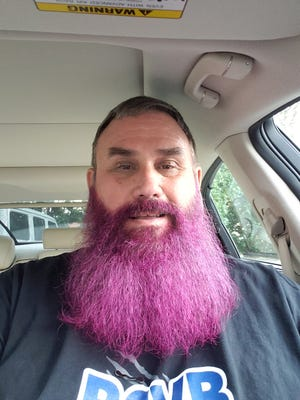 Barron Collier High School athletic director Ken Andiorio agreed to dye his beard pink if students raised money for breast cancer. The students raised close to $3,000, and Andiorio got his facial hair colored on Thursday, Oct. 22, 2020.