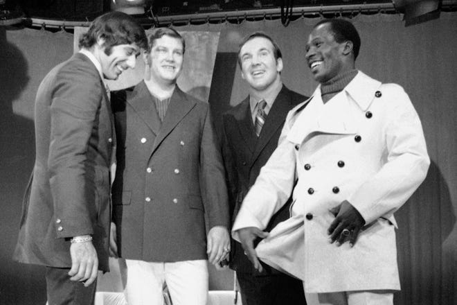 In this Dec. 8, 1969, file photo, from left, New York Jets' Joe Namath, Bill Mathis, Pete Lammons and Emerson Boozer model Cardin Resort clothes during a New York City taping of the Joe Namath TV show. Bill Mathis, a versatile running back and an original member of the Jets franchise, has died. He was 81.