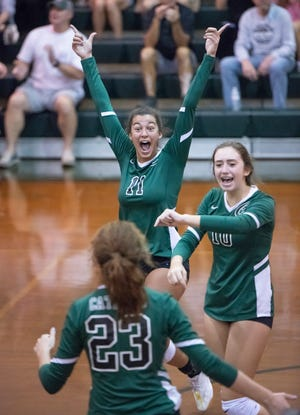 Amiah Butler (11) and teammates celebrate a point during the Jacksonville Episcopal vs Catholic Region 1-3A quarterfinal volleyball match at Pensacola Catholic High School on Thursday, Oct, 22, 2020.