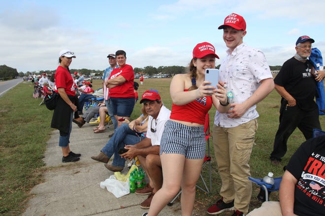 Florida State University students Elisabeth Akerson and Dustin Batchelor take a selfie Friday, Oct. 23, 2020, at the front of line forming ahead of President Donald Trump's rally at the ST Engineering hangar near the Pensacola International Airport.